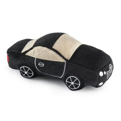 A plush dog toy in the shape of a luxury car