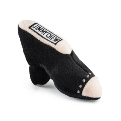 Plush dog toy in the shape of a foot in a black high-heeled shoe